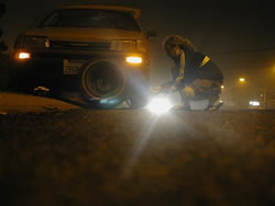 Changing a Tire at Night
